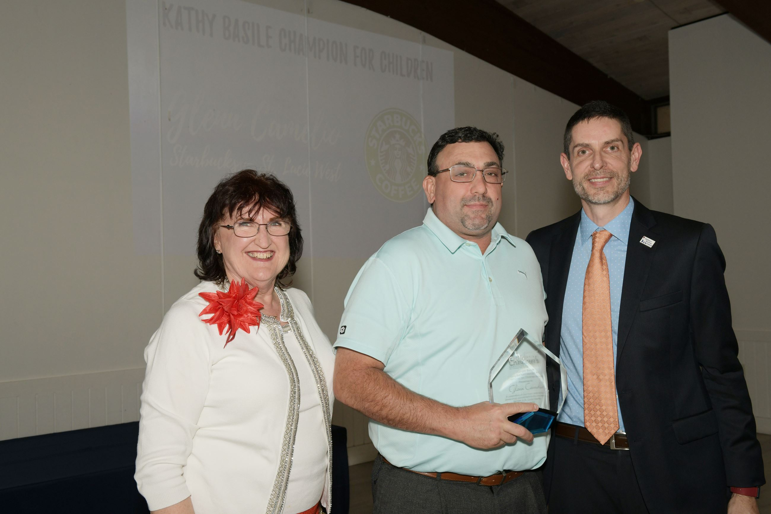 Kathryn Hensley, Kathy Basile Champion for Children award winner Glenn Camelio of Starbucks SLW a