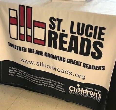 Table cover with St. Lucie Reads logo
