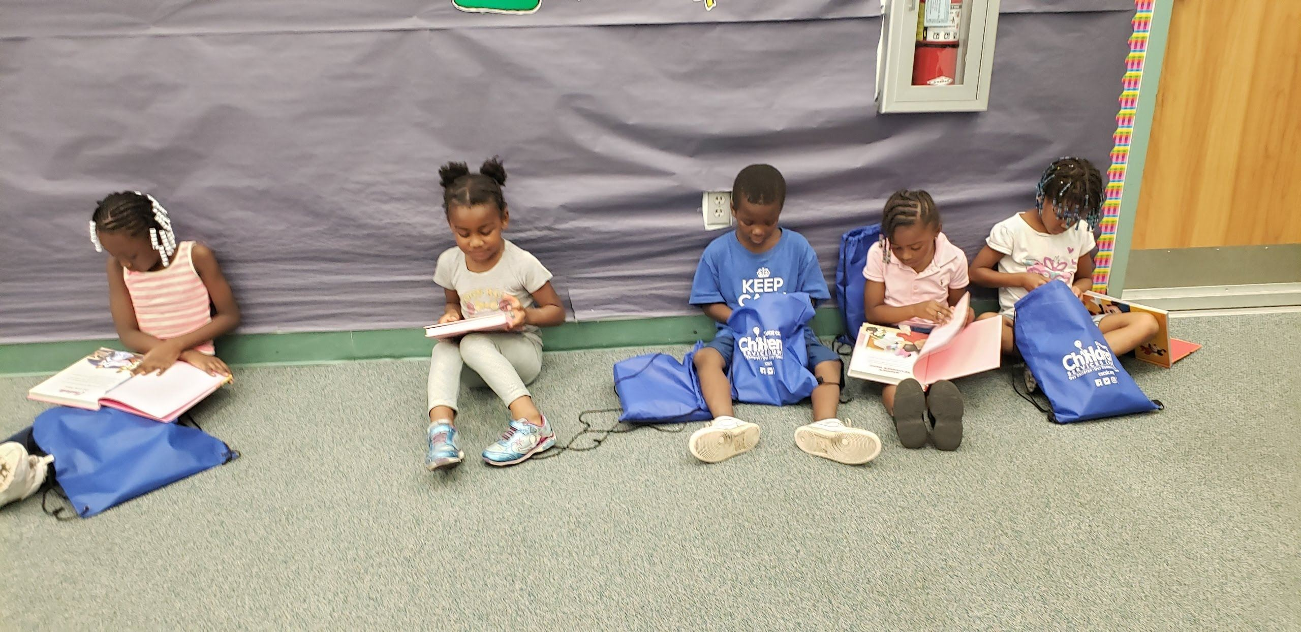 Children reading their book during bookfair -June 2019