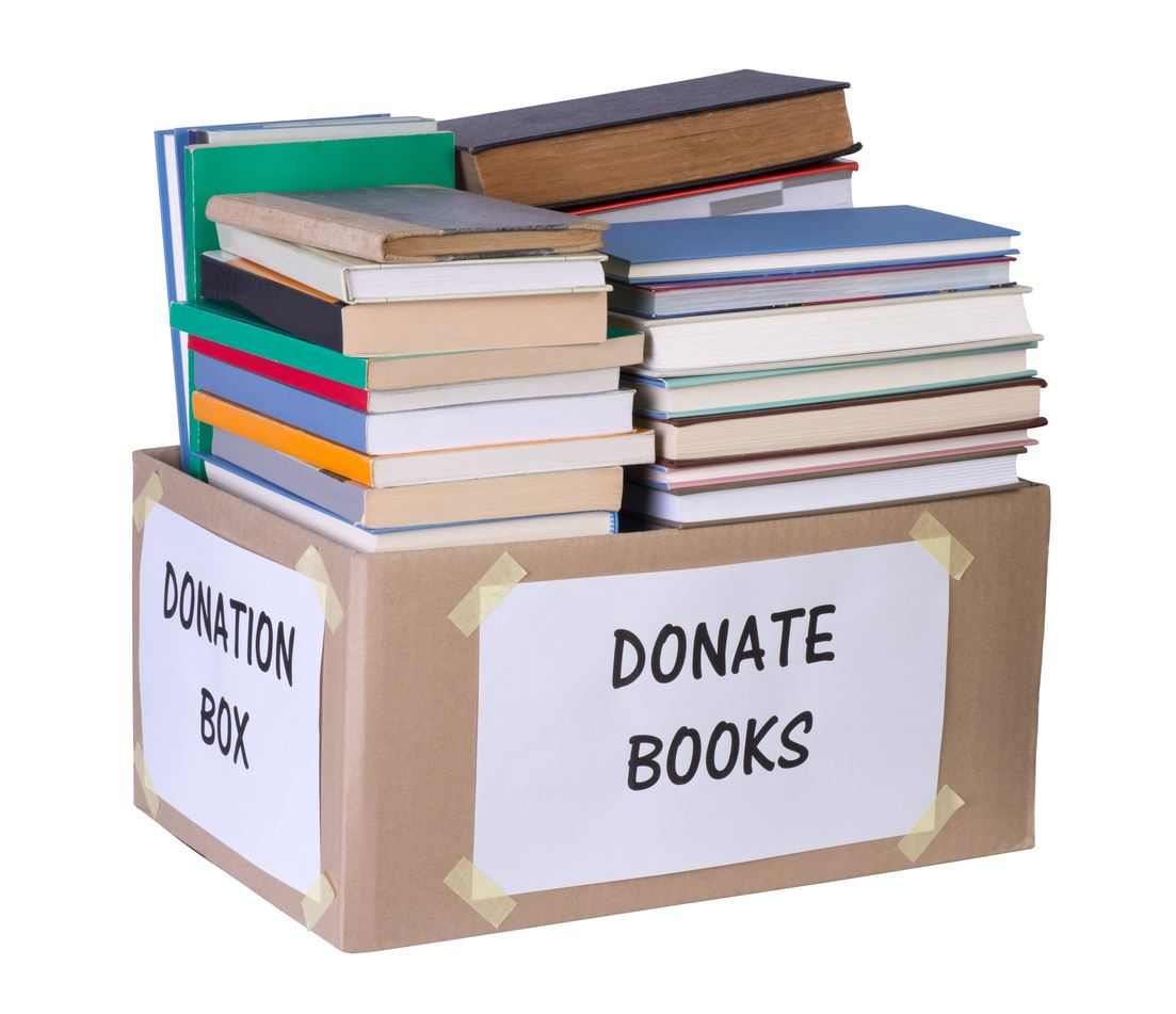 A donation box filled with books